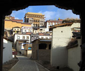 A centuries-old monastery overlooks the town of Shangra-La, along the ancient Tea-Horse Road on The California Native China Tours